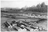 Hospital and dormitories shipped to Aden were situated at the foot of a mountainous landscape.