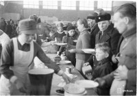 Evacuated Karelians are provided with a meal at the Savonlinna plywood factory in March 1940.